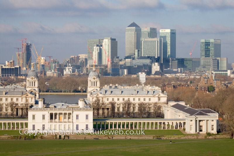 Queens house, old Royal Naval College and docklands seen from Greenwich Park, London