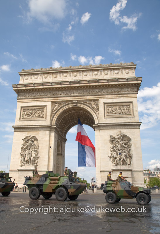 French Military vehicles driving past the Arc De Triomphe on Bastille day