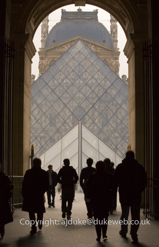 People visiting the Pyramid at the Louvre museum, Paris
