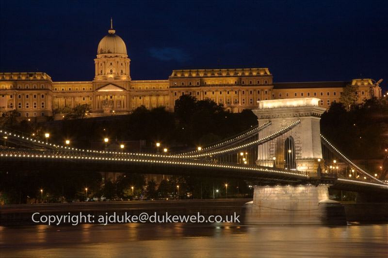 Chain Bridge over the Danube river and Royal Palace on Castle Hill at night, Budapest