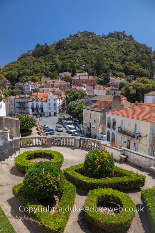 Palace gardens and Sintra historical old town with Moorish castle on the hill behind, Portugal