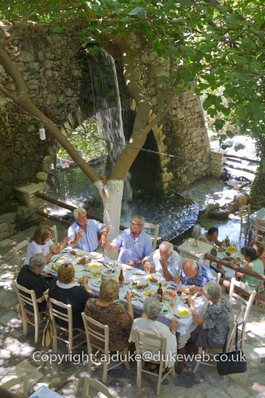 Mountain springs flowing through a taverna, Argyroupolis, Crete, Greece