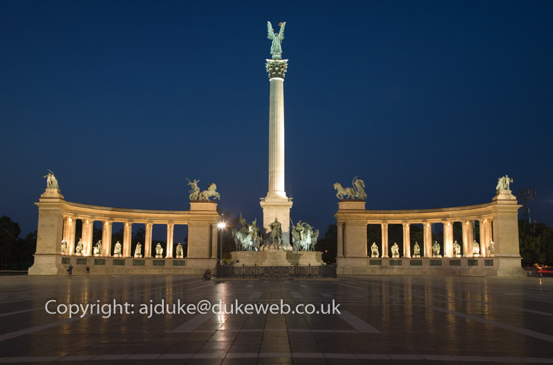 Heroes Square, Hosok Ter, with the Millenary Monument pillar after dark, Budapest