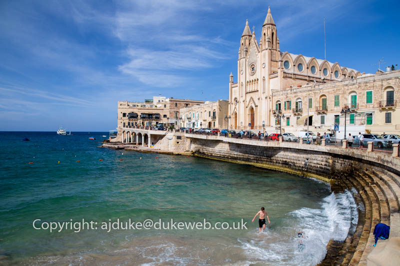 Balluta Bay area of St.Julian's Bay and Church of Our Lady of Mount Carmel, Malta