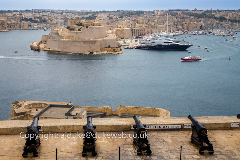 View from Valetta Upper Barrakka gardens over the Saluting Battery cannons to the Grand Harbour and Senglea Three Cities area, Malta
